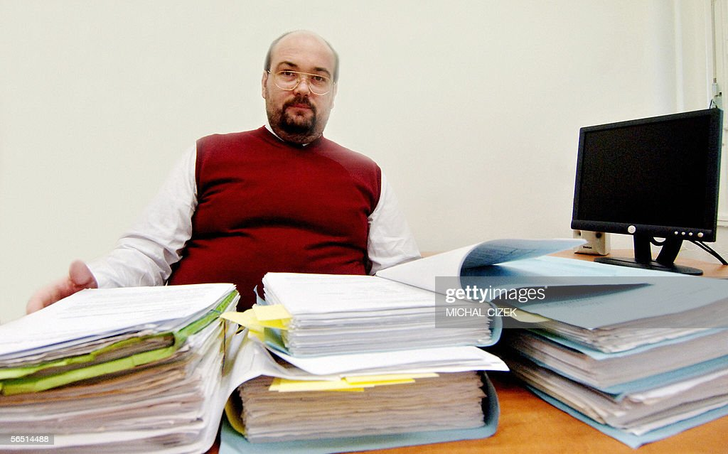 Czech Chief Secretary of State Attorney Martin Omelka pages in the investigatory file of practically 50 year-old story of a bomb attack on former French Bas-Rhin prefect Andre-Marie Tremeaud, 03 January 2006 in his office in Prague. Tremeaud's whose wife, Henriette, was killed in 1957 by the explosion of a booby-trapped box of cigars. The French services reportedly quickly discovered that the attack was planned by the Soviet secret police KGB and their Czech partners, in revenge for a wave of arrests of activists in France, which had neutralized a KGB attempt to sow discord among the European allies. The cigar box delivered to the prefect's office by the post was allegedly intended to explode during a meeting of the European Coal and Steel Community set at Strasbourg, and it might have, if Madame Tremeaud's curiosity had not tempted her to try to open it discreetly with a knife. The French reportedly searched for years for the Czech agents responsible for the attack, and finally traced them to Prague where, 48 years after the crime, two former members of the Statni Bezpecnost (STB) communist police, today aged 78, are to be tried in coming months, two other co-accused spies having died in the meantime, according to the Czech Interior Ministry. Tremeaud died at Neuilly-sur-Seine in 1993 at the age of 90.