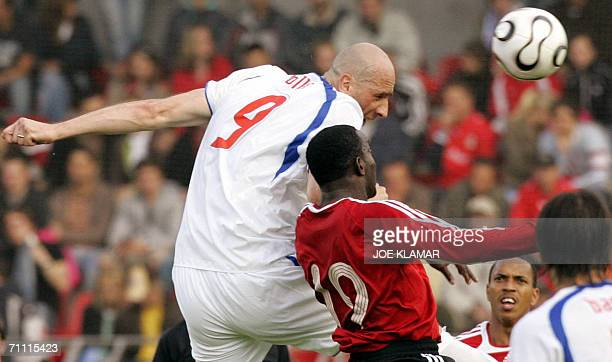 Czech striker Jan Koller and Dwight Yorke of Trinidad and Tobago on a header during a friendly match between the Czech Republic and Trinidad and...