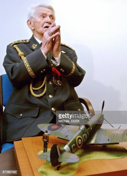 Czech World WarII pilot Frantisek Perina gestures 05 April 2006 in Prague after receiving from the Czech military on the occasion of his 95th...
