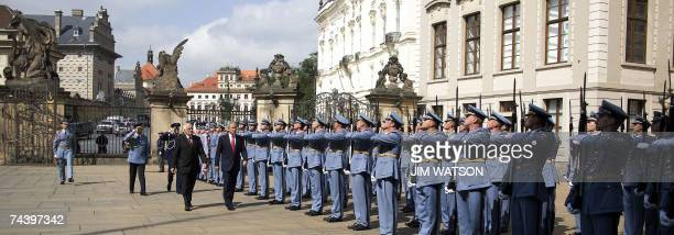 US President George W Bush walks with Czech Republic President Vaclav Klaus as they inspect an honour guard 05 June 2007 during a welcoming ceremony...