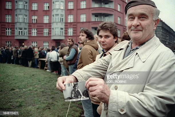A Prague inhabitant displays 10 December 1988 in Prague a picture of Vaclav Havel a dissident playwright leading member of the Czechoslovak...