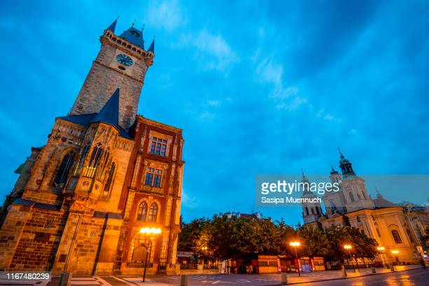 prague old town hall and saint nicholas' church in the early morning, czech republic. - st nicholas' church stock pictures, royalty-free photos & images