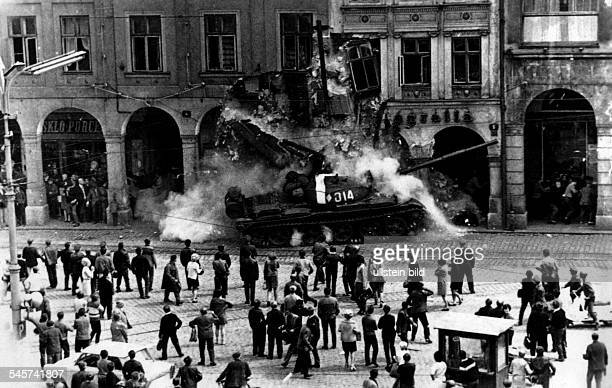 Prague Spring Suppression Invasion of Czechoslovakia by troops of the Warsaw Pact countries| a Soviet tank is driving into the facade of a building...