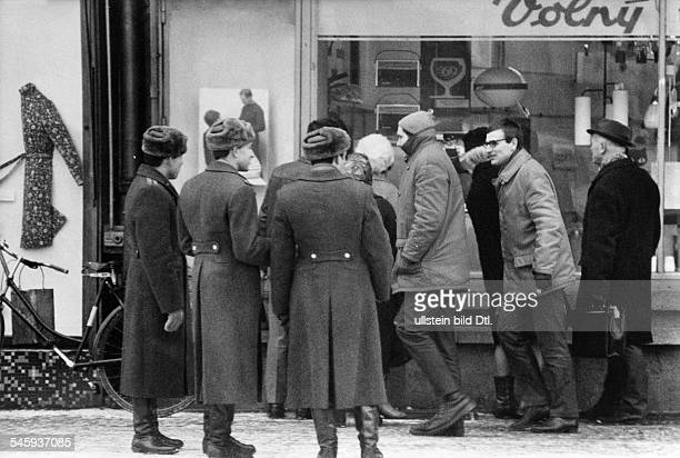 Prague Spring Suppression Invasion of Czechoslovakia by troops of the Warsaw Pact countries| Soviet soldiers before a radio shop in Mlada Boleslav...