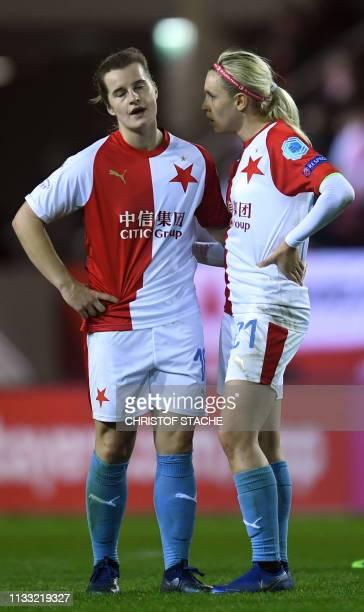 Prague's player Ashley Herndon and Katerina Svitkova react after the UEFA women's Champions League quarterfinal secondleg football match between FC...