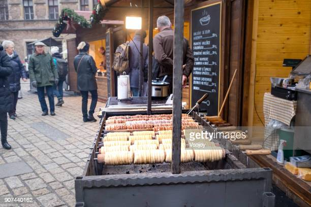 prague's trdelnik pastries - one of the most common pastries to find on streets - vsojoy stock pictures, royalty-free photos & images