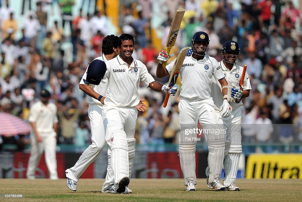 Pragyan Ojha and VVS laxman and Suresh Raina of India celebrate their win on day five of the First Test match between India and Australia at Punjab...