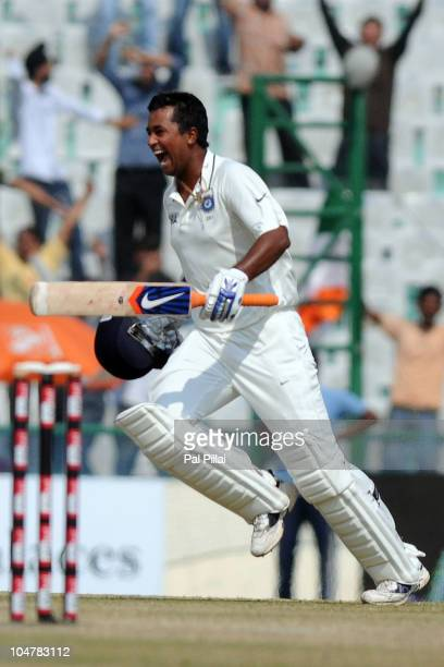 Pragyan Ojha of India celebrates the win on day five of the First Test match between India and Australia at Punjab Cricket Association Stadium on...
