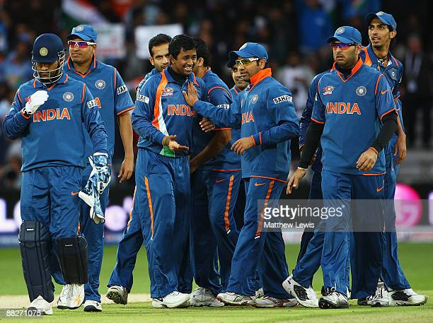 Pragyan Ojha of India is congratulated on the wicket of Shakib Al Hasan of Bangladesh during the ICC World Twenty20 match between India and...