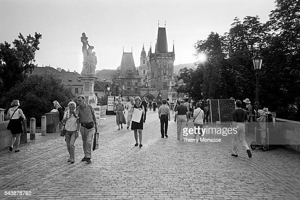 Praha Czech Republic June 2000 Tourists enjoy the Charles Bridge Its construction started in 1357 under the auspices of King Charles IV designed by...