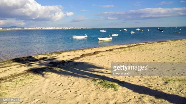 praia de faro, faro, portugal - faro city portugal stock photos and pictures