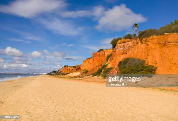 praia do garrão poente (dunas douradas). faro. portugal - faro city portugal stock photos and pictures