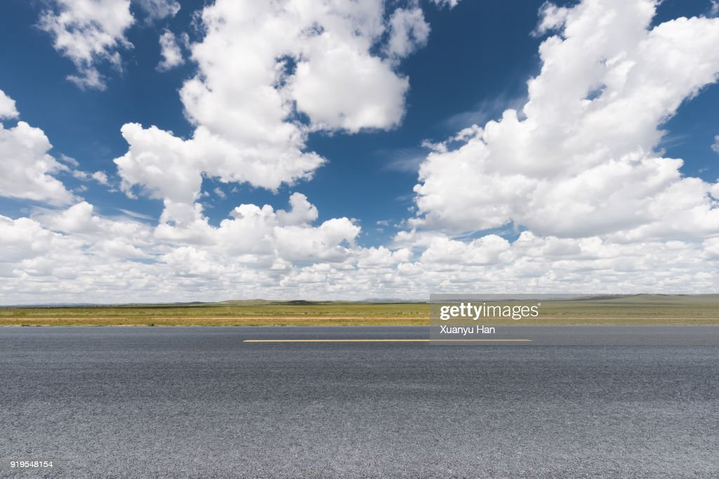 Prairie landscape and rural highway. : Stock Photo