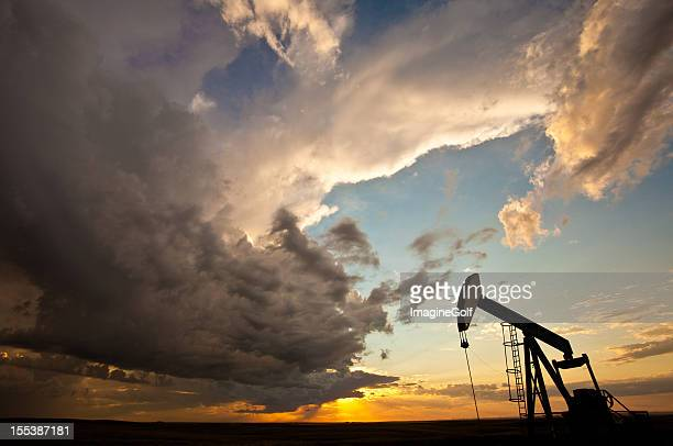 prairie pumpjack silhouette - great plains stock pictures, royalty-free photos & images