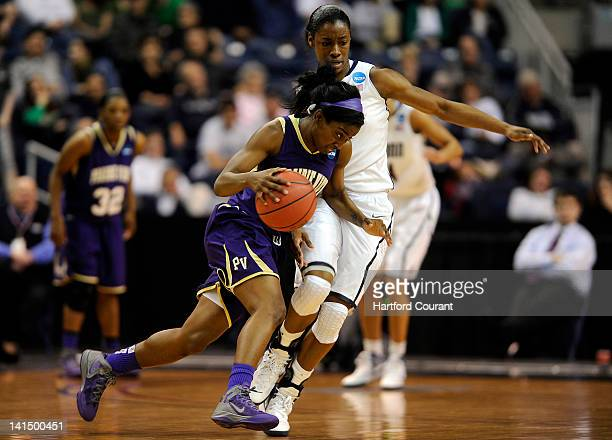 Prairie View AM's Lereahn Washington left puts her head down and drives around Connecticut's Brianna Banks during game action in the 2012 NCAA...