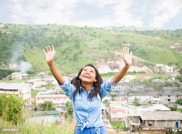 praise!  asian girl gives thanks as she lifts arms upward. - worshipper stock pictures, royalty-free photos & images