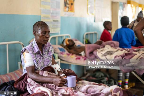 Praise Chipore a cyclone survivor sits on a hospital bed at Chimanimani Rural district hospital Manicaland Province eastern Zimbabwe on March 18 2019...