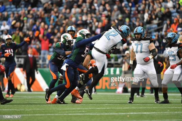 Praise Martin-Oguike of the Seattle Dragons hits Landry Jones of the Dallas Renegades during the XFL game at CenturyLink Field on February 22, 2020...