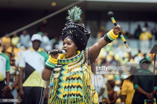 A praise singer takes to the stage to traditionally welcome African National Congress President Cyril Ramaphosa during the African National Congress'...
