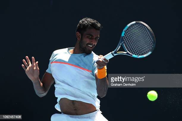 Prajnesh Gunneswaran of India plays a forehand in his match against Yosuke Watanuki of Japan during Qualifying ahead of the 2019 Australian Open at...