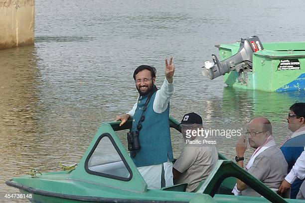 Prakash Javadekar India's new Union Minister of State for Environment and Forest and Information and Broadcasting rides a boat with his companions to...