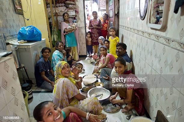 Prakesh with his two wives and 12 children share lunch together in the family home in Dharavi on November 4 2011 in Mumbai India Dharavi Asia's...