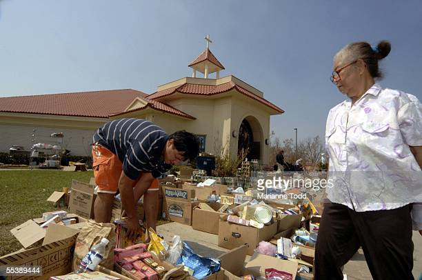 Prakong Lee and David Lee of Thailand search for food at Martyrs Catholic Church on Oak Street September 12 2005 in Biloxi Mississippi Since...