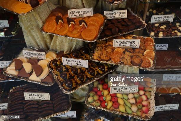 Pralines of chocolate marzipan dried fruit chestnuts and other confectionery lie on display at Bonbons Anzinger in the city center on October 16 2017...