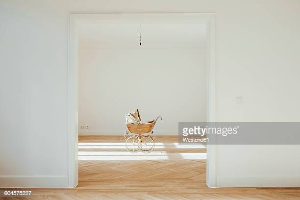 pram in empty room, open doors - carriage stock pictures, royalty-free photos & images