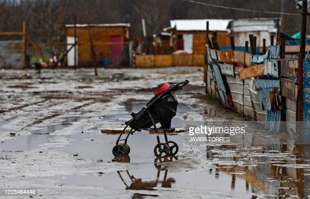 Pram is seen in a waterlogged street in a poor sector of Santiago on June 29, 2020 after heavy rains fell in central and southern Chile. - Intense...