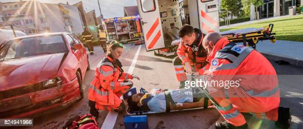 Pramedics on a scene of car accident