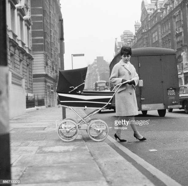 Pramway Code Mother crossing road with pram Knightsbridge London 10th January 1967 The Royal Society for the Prevention of Accidents have launched a...
