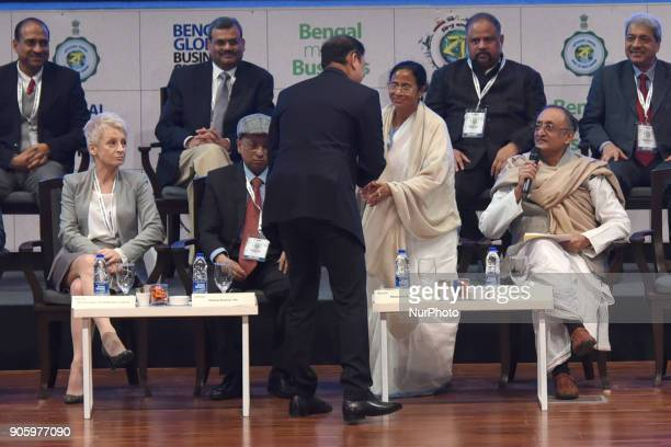Pranav AdaniDirector of Adani Enterprises shake hand to Mamata Banerjee Chief Minister of West Bengal and Amit Mitra State Finances Minister look at...