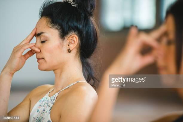 pranayama breathing exercises. women practicing yoga position - breathing exercise stock pictures, royalty-free photos & images