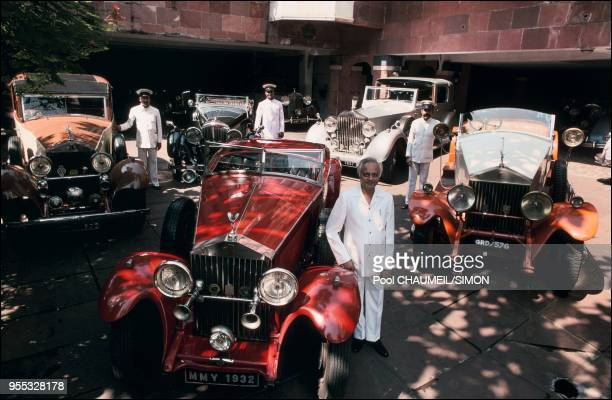 Pranlal Boghilal surrounded by his Rolls and Bentley in Bombay.