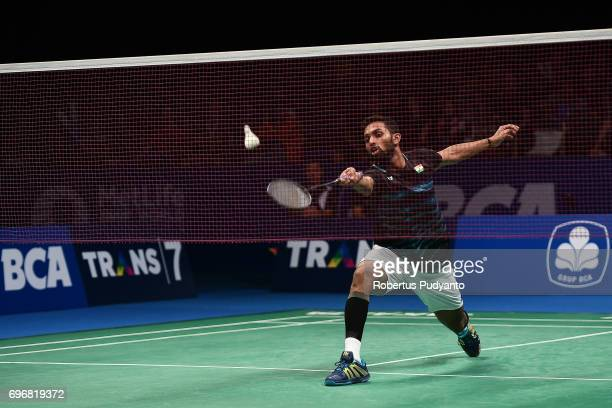 Prannoy H S of India competes against Kazumasa Sakai of Japan during Mens Single Semifinal match of the BCA Indonesia Open 2017 at Plenary Hall...