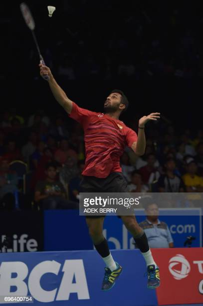 Prannoy HS of India plays a return against Lee Chong Wei of Malaysia during the men's singles badminton match at the Indonesia Open in Jakarta on...