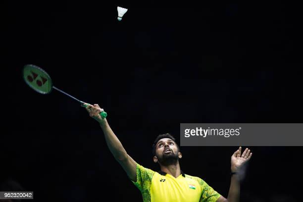 TOPSHOT Prannoy Kumar of India hits a return against Chen Long of China during their men's singles semifinals match at the 2018 Badminton Asia...