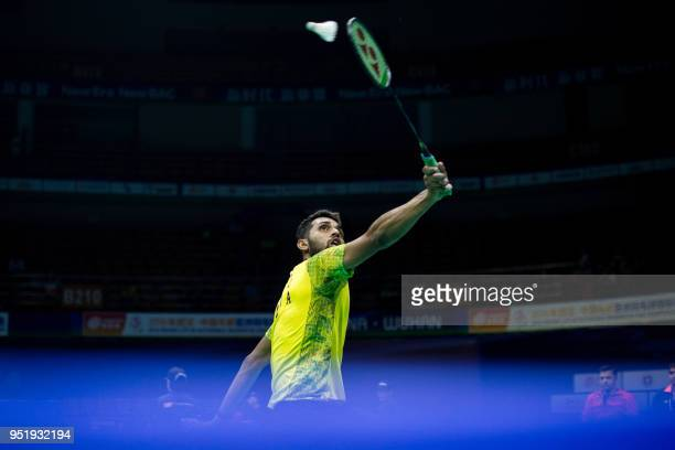 Prannoy Kumar of India hits a return against Son Wan Ho of South Korea during their men's singles quarterfinals match at the 2018 Badminton Asia...