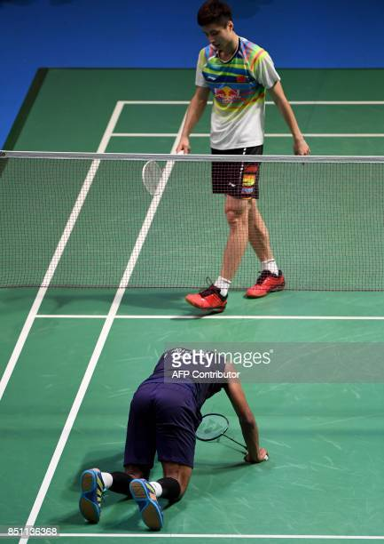 HS Prannoy of India falls on the court during the men's singles quarterfinal match against Shi Yuqi of China at the Japan Open Badminton...