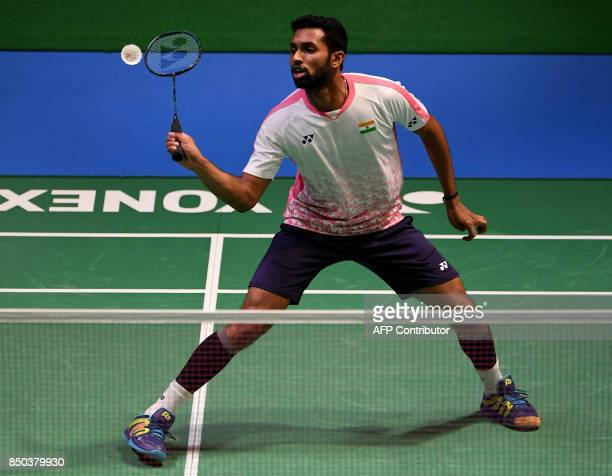 HS Prannoy of India hits a return against Hsu Jenhao of Taiwan during their men's singles second round match at the Japan Open Badminton...