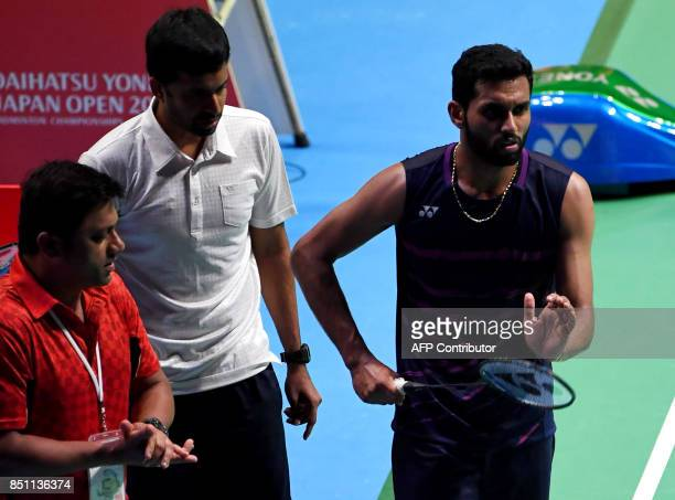 HS Prannoy of India listens to his coaches during the men's singles quarterfinal match against Shi Yuqi of China at the Japan Open Badminton...