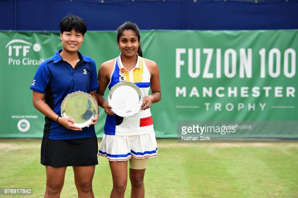 Prarthana Thombare of India and Luksika Kumkhum of Thailand celebrate victory in the Womens Doubles Final during Finals Day of the Fuzion 100...
