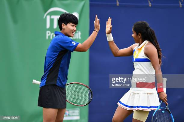 Prarthana Thombare of India reacts with Luksika Kumkhum of Thailand in the Womens Doubles Final during Finals Day of the Fuzion 100 Manchester Trophy...