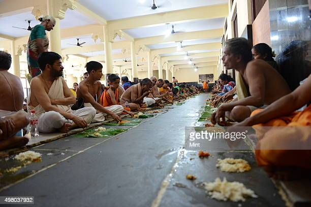 Prasadam is being offered to the pilgrims after the afternoon puja for Brahmin community food been served on Banana leaf in a different dining hall...
