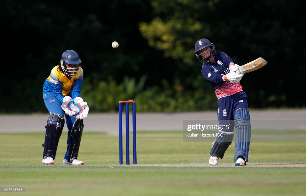 Prasadani Weerakkodi of Sri Lanka looks on as Danielle Wyatt of England hits out during The ICC Women's World Cup warm up match between England and Sri Lanka at Queens Park on June 19, 2017 in Chesterfield, England.