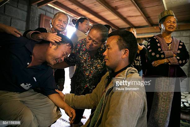 Prasert Teud Prai Panawan grieves the loss of his daughter Chomphu age 8 during a memorial service in the Hmong community of Jom Thong Chiang Mai...