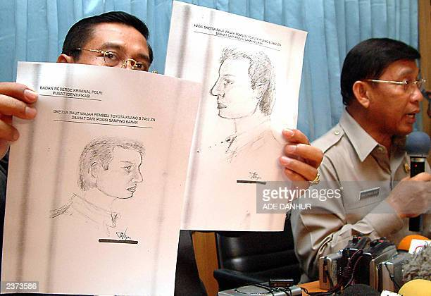Prasetyo Jakarta Police spokesman holds a sketch of purchaser of Kijang car which used to exploded JW Marriott Hotel as Indonesian police detective...