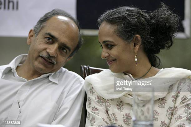 Prashant Bhushan a member of Lokpal Bill drafting committee with author and activist Arundhati Roy during a public convention against corruption in...