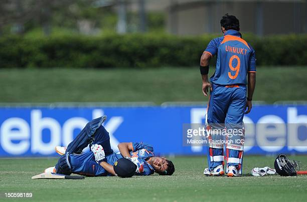 Prashant Chopra of India lays on the ground in pain after being hit in the groin by a ball from Ed Nuttall during the ICC U19 Cricket World Cup 2012...